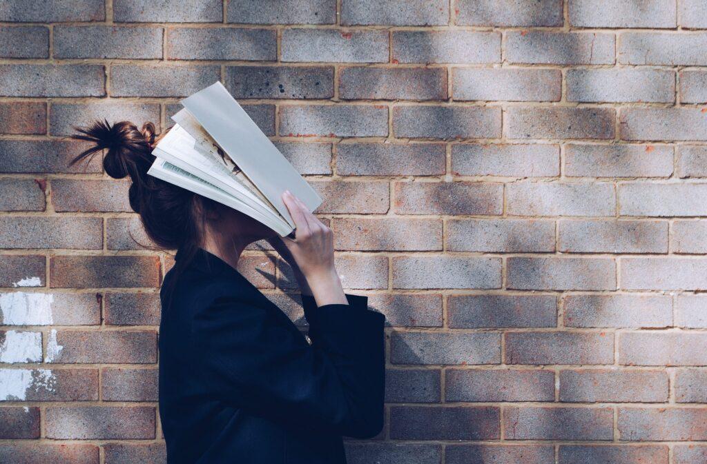 a girl who has a textbook