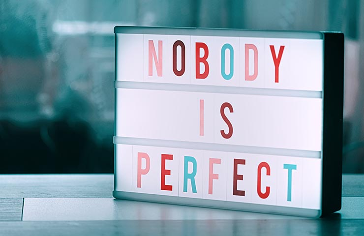 「Nobody is perfect」の文字